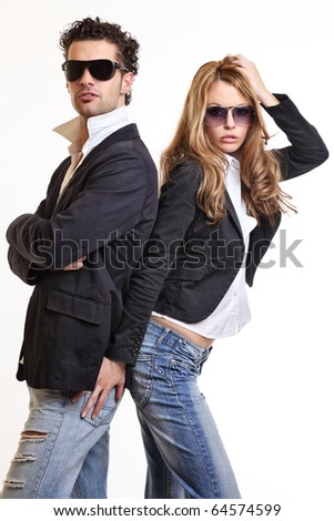 young sexy couple posing in studio - stock photo