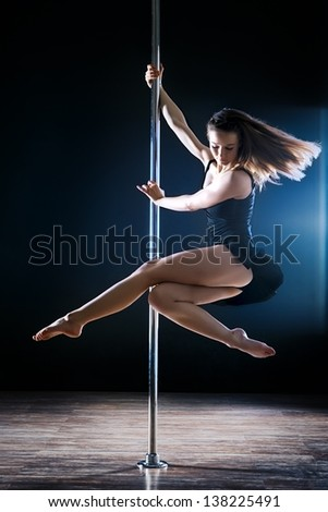 young sexy dance woman turning on pole - stock photo