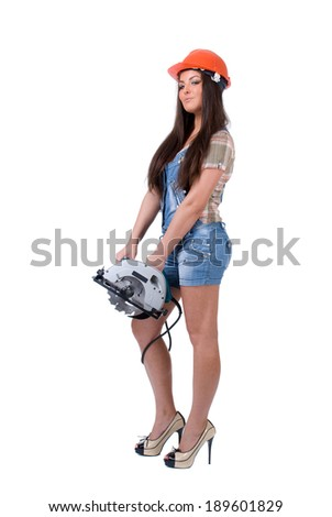 Young sexy female dressed in jeans and orange helmet holding an electric circular disk saw. On a white isolated background