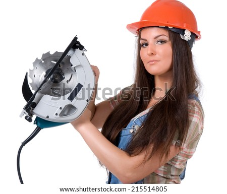 Young sexy female dressed in jeans and orange helmet holding an electric circular disk saw. On a white isolated background - stock photo