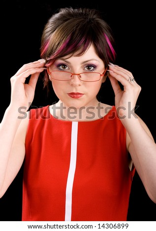 Young sexy female teacher in a red dress - stock photo