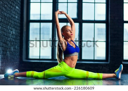Young sexy fitness woman stretching. - stock photo