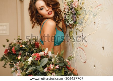 young sexy girl in erotic lingerie beautiful interior - stock photo