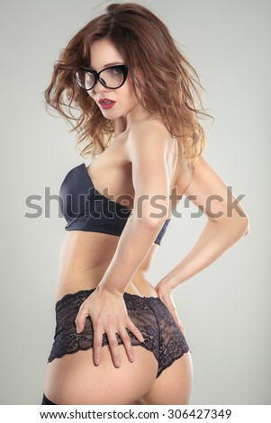 young sexy girl in erotic lingerie studio - stock photo