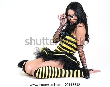 Young sexy girl in the bee costumes - stock photo