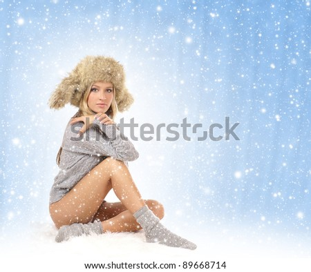 Young sexy girl in winter dress - stock photo
