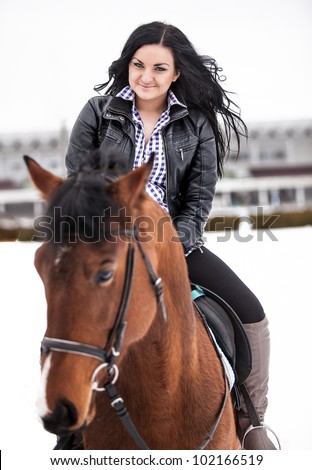 Young sexy girl riding horse - stock photo