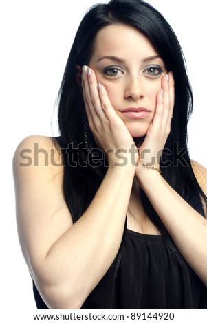 Young sexy girl with attitude holding face against white background - stock photo