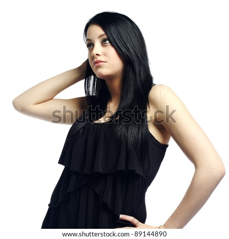 Young sexy girl with attitude looking away against white background - stock photo