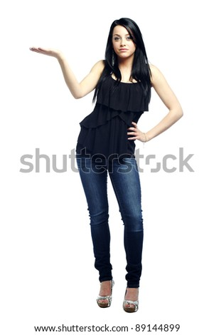 Young sexy girl with attitude with hand out against white background - stock photo