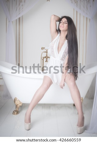 young sexy lady woman posing in bath. amazing body - stock photo