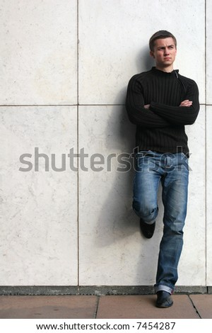 Young sexy man at the marble background