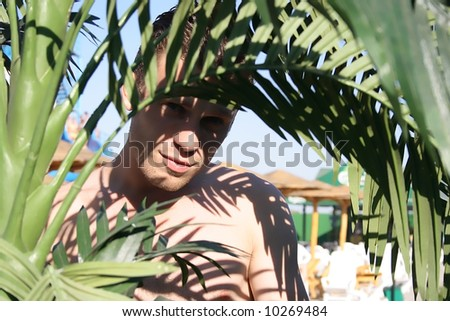 Young sexy man enjoying nature - stock photo