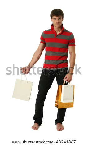 Young sexy man holding copy space shopping bags isolated on white