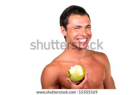 Young sexy man Holding Green Apple - stock photo