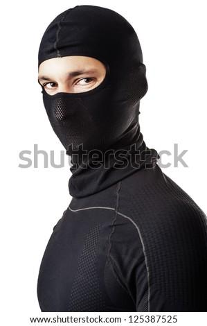 Young sexy man in black ski mask - balaclava - stock photo