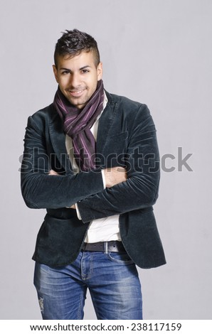 Young sexy man in studio shot with casual clothes - stock photo