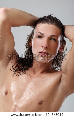 Young sexy man in towel isolated on white background