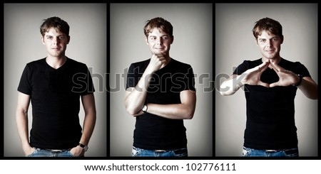 Young sexy man model in black t-shirt on gray background - stock photo