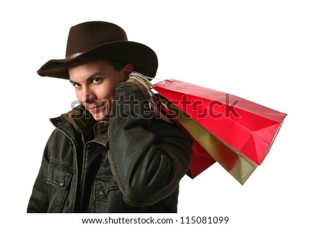 Young sexy man wearing a cowboy hat with shopping bags isolated on white - stock photo