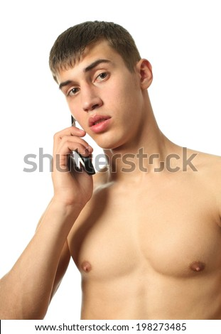 Young sexy man with a cell phone isolated on white - stock photo