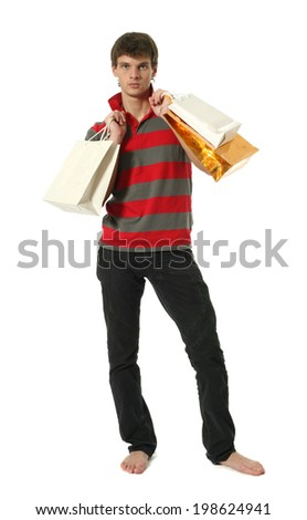 Young sexy man with copy space shopping bags isolated on white