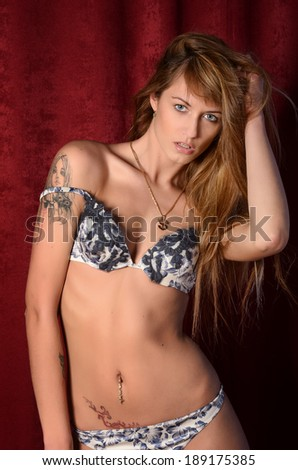 Young sexy model in lingerie - stock photo