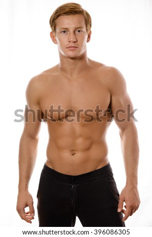 young sexy muscular macho man posing with naked torso on white background - stock photo
