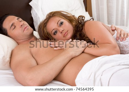 Young sexy naked heterosexual couple love in bed - stock photo