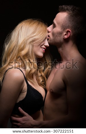 Young sexy passionate lovers in intimate moment