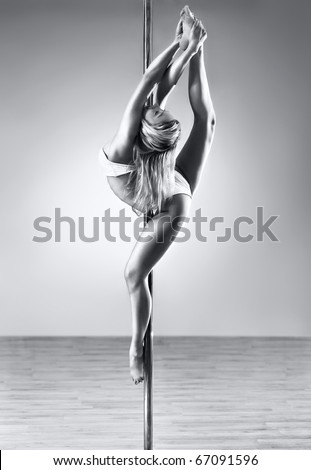 Young sexy pole dance woman. Black and white colors. - stock photo