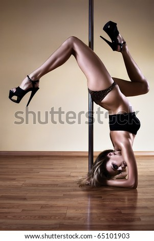 Young sexy pole dance woman. Contrast colors. - stock photo