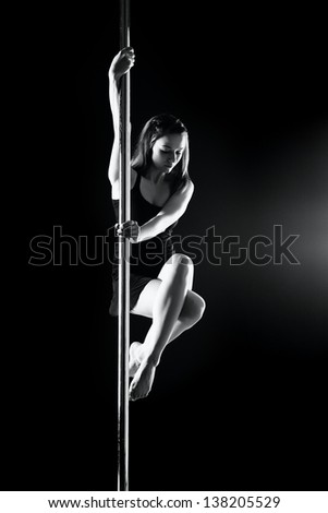 young sexy pole dance woman, dark background - stock photo