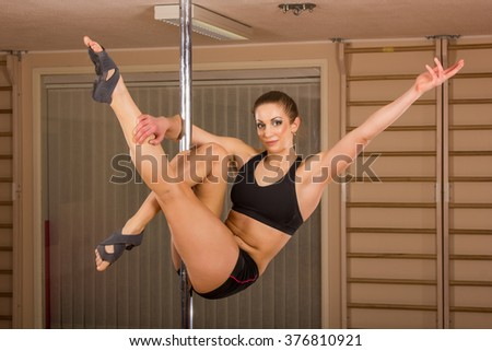 young sexy Pole Dancer - stock photo