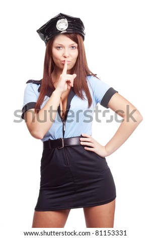 young sexy policewoman, telling us to be silent, isolated against white background - stock photo