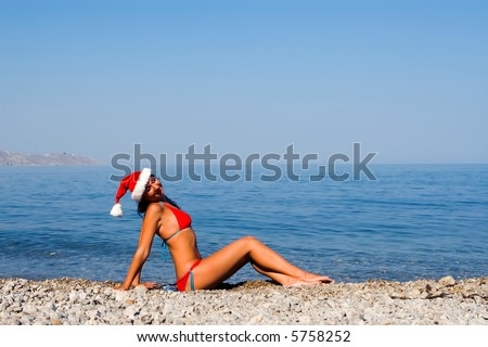 young sexy santa girl in the sea