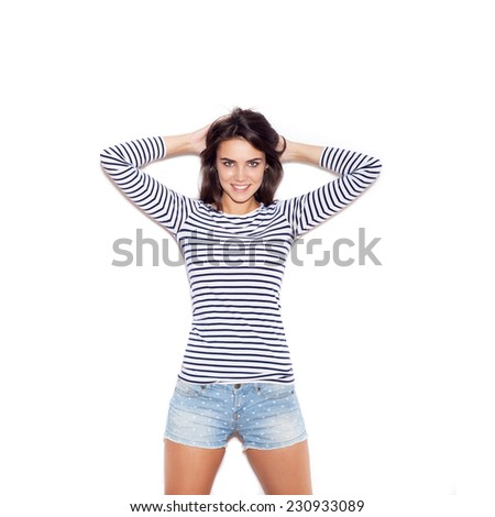 Young sexy skater girl. Outdoor fashion portrait of young beautiful woman in t-shirt, shorts and cap. - stock photo