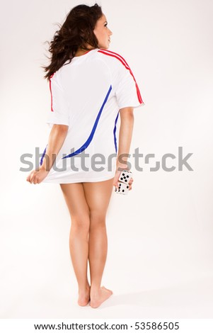 Young sexy soccer woman, dressed in white . - stock photo