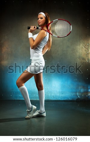 Young sexy tennis player woman. - stock photo