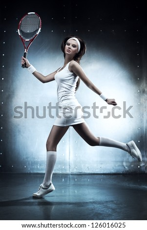 Young sexy tennis player woman running. Blue and white colors. - stock photo