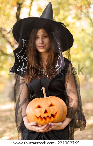 Young sexy witch making the witchcraft