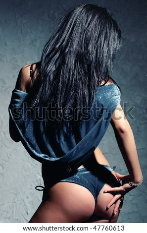 Young sexy woman. Backside view. - stock photo
