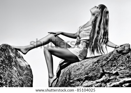 Young sexy woman. Black and white colors. - stock photo