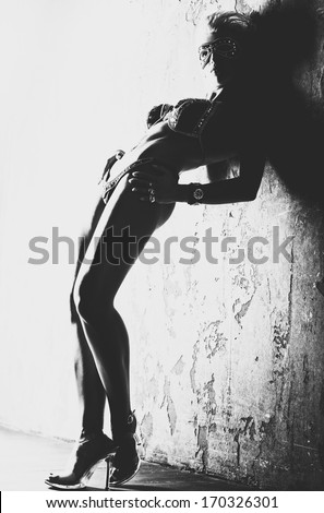 Young sexy woman. Black and white film style colors. - stock photo