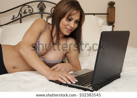 Young sexy woman flirts on cam - stock photo