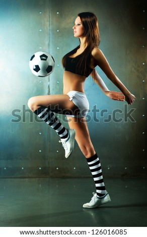 Young sexy woman football player. - stock photo