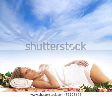 Young sexy woman getting spa treatment isolated on resort background - stock photo