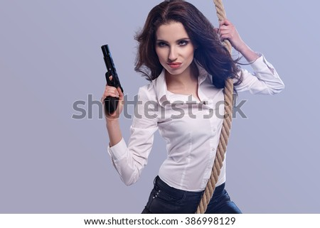 Young  sexy Woman holding Handgun in hand - stock photo