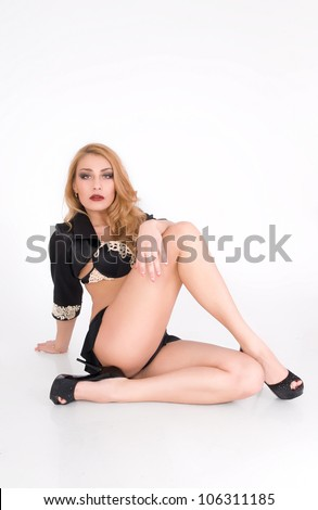 Young sexy woman in a provocative pose with high heel shoes - stock photo