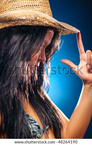 Young sexy woman in cowboy hat portrait. Shallow dof. - stock photo